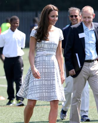 Catherine, Duchess of Cambridge kicks a football on the football pitch as she visits Bacon's College on July 26, 2012 in London, England. Prince Harry, Prince William, Duke of Cambridge and Catherine, Duchess of Cambridge visited Bacon's College and launched the 'Coach Core' Programme, a partnership between their Foundation and Greenhouse.