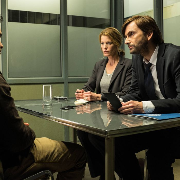 GRACEPOINT: Mark Solano (Michael Pe?a, L) is questioned by Detectives Emmett Carver (David Tennant, R) and Ellie Miller (Anna Gunn, C) in