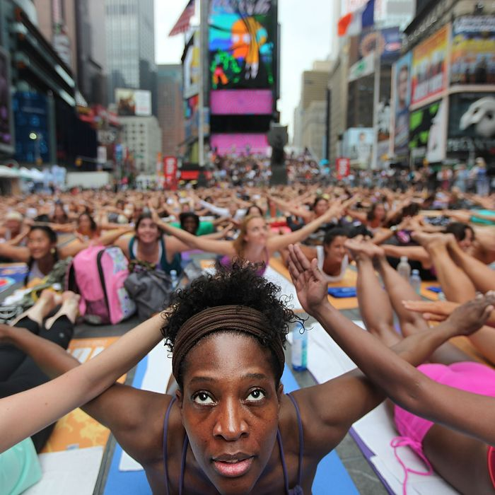 Bernice Acosta and other enthusiast perform yoga in Times Square during an event marking the summer solstice on June 21, 2011 in New York City. Thousands of yogis will attend the free day-long event in Manhattan on the longest day of the year.