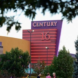 AURORA, CO - JULY 23: People stand in the parking lot outside the Century 16 movie theater where 12 people were killed in a shooting rampage last Friday, on July 23, 2012 in Aurora, Colorado. Suspect James Holmes, 24, allegedly went on a shooting spree and killed 12 people and injured 58 during an early morning screening of 'The Dark Knight Rises.' (Photo by Kevork Djansezian/Getty Images)