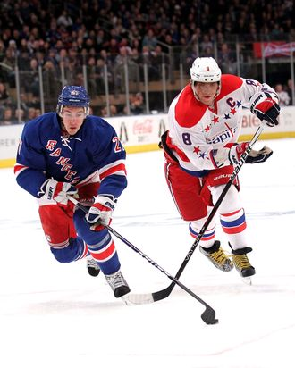 Ryan McDonagh #27 of the New York Rangers skates with the puck in front of Alex Ovechkin #8 of the Washington Capital