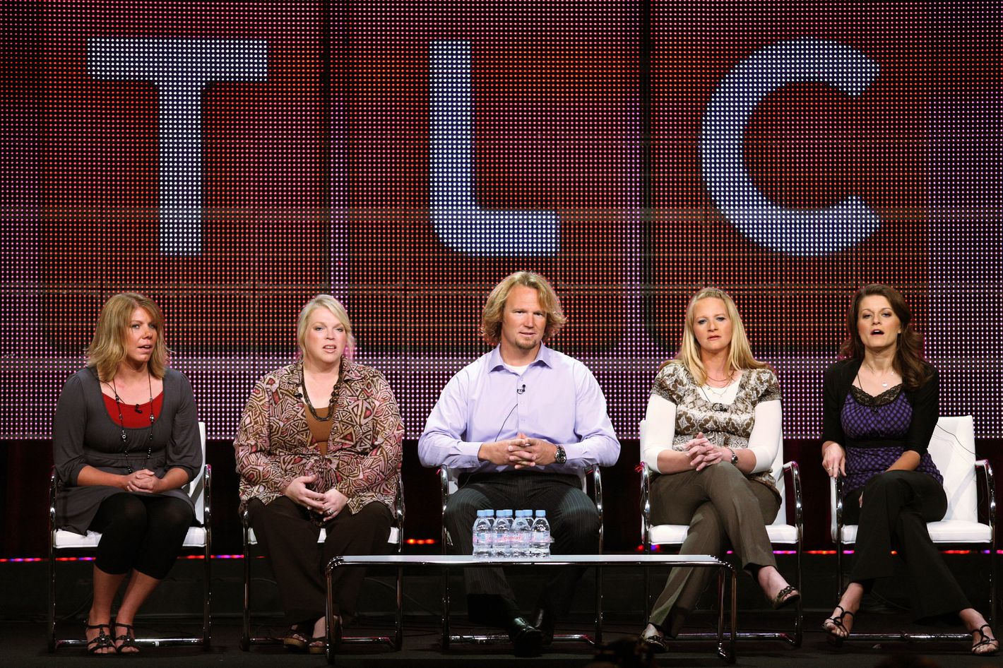 """BEVERLY HILLS, CA - AUGUST 06:  TV personalities Meri Brwon, Janelle Brown, Kody Brown, Christine Brown and Robyn Brown speak duinrg the """"Sister Wives"""" panel during the Discovery Communications portion of the 2010 Summer TCA pres tour held at the Beverly Hilton Hotel on August 6, 2010 in Beverly Hills, California.  (Photo by Frederick M. Brown/Getty Images)"""