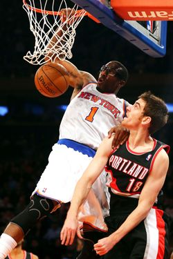 Amar'e Stoudemire #1 of the New York Knicks dunks the ball over Victor Claver #18 of the Portland Trail Blazers on January 1, 2013 at Madison Square Garden in New York City. The Portland Trail Blazers defeated the New York Knicks 105-100.