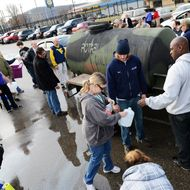 West Virginia American Water customers line up for water at the Gestamp Plant after waiting hours for a water truck, only to have it empited in about 20 minutes on January 10, 2014 in South Charleston, West Virginia.