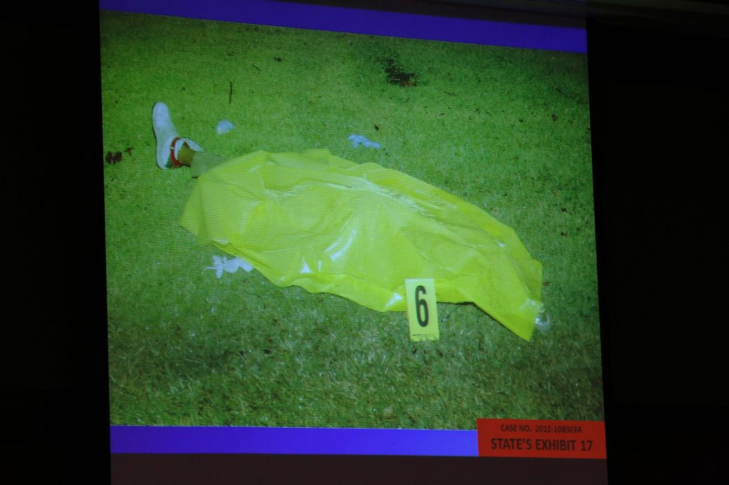 The State of Florida shows photos of Trayvon Martin from the night of the shooting as evidence during George Zimmerman's trial in Seminole circuit court June 25, 2013 in Sanford, Florida. Zimmerman is charged with second-degree murder for the February 2012 shooting death of 17-year-old Trayvon Martin.