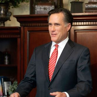 Former Massachusetts governor and Republican presidential candidate Mitt Romney addresses questions about his faith and his wife's stance on abortion during a press conference before a town hall meeting on May 9, 2007 in Ames, Iowa.