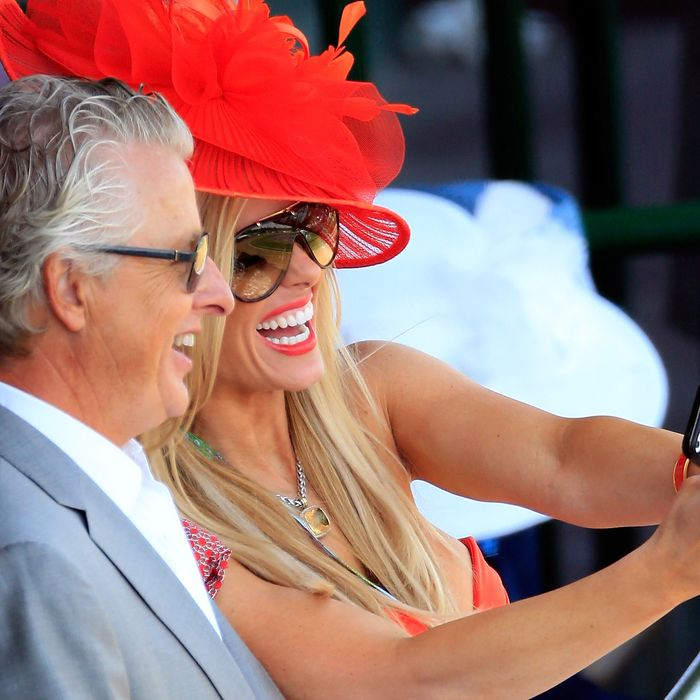 Spectators take a selfie prior to the 140th running of the Kentucky Derby at Churchill Downs on May 3, 2014 in Louisville, Kentucky.