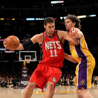 LOS ANGELES, CA - JANUARY 14: Brook Lopez #11 of the New Jersey Nets drives against Pau Gasol #16 of the Los Angeles Lakers at Staples Center on January 14, 2011 in Los Angeles, California. The Lakers won 100-88. NOTE TO USER: User expressly acknowledges and agrees that, by downloading and or using this photograph, User is consenting to the terms and conditions of the Getty Images License Agreement. (Photo by Stephen Dunn/Getty Images) *** Local Caption *** Brook Lopez;Pau Gasol