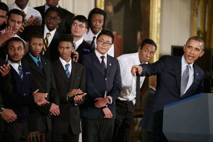 WASHINGTON, DC - FEBRUARY 27: U.S. President Barack Obama (R) delivers remarks about his 'My Brother's Keeper' initiative with students from the Hyde Park Academy in the East Room at the White House February 27, 2014 in Washington, DC. As part of his 'Year of Action,' Obama announced a $200 million commitment from nine foundations to bolster the education and employment of young men and boys of color. (Photo by Chip Somodevilla/Getty Images)