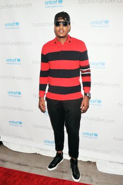 "NBA basketball player Carmelo Anthony attends the ""A Year In A New York Minute"" photo exhibition at Canoe Studios on September 26, 2012 in New York City."