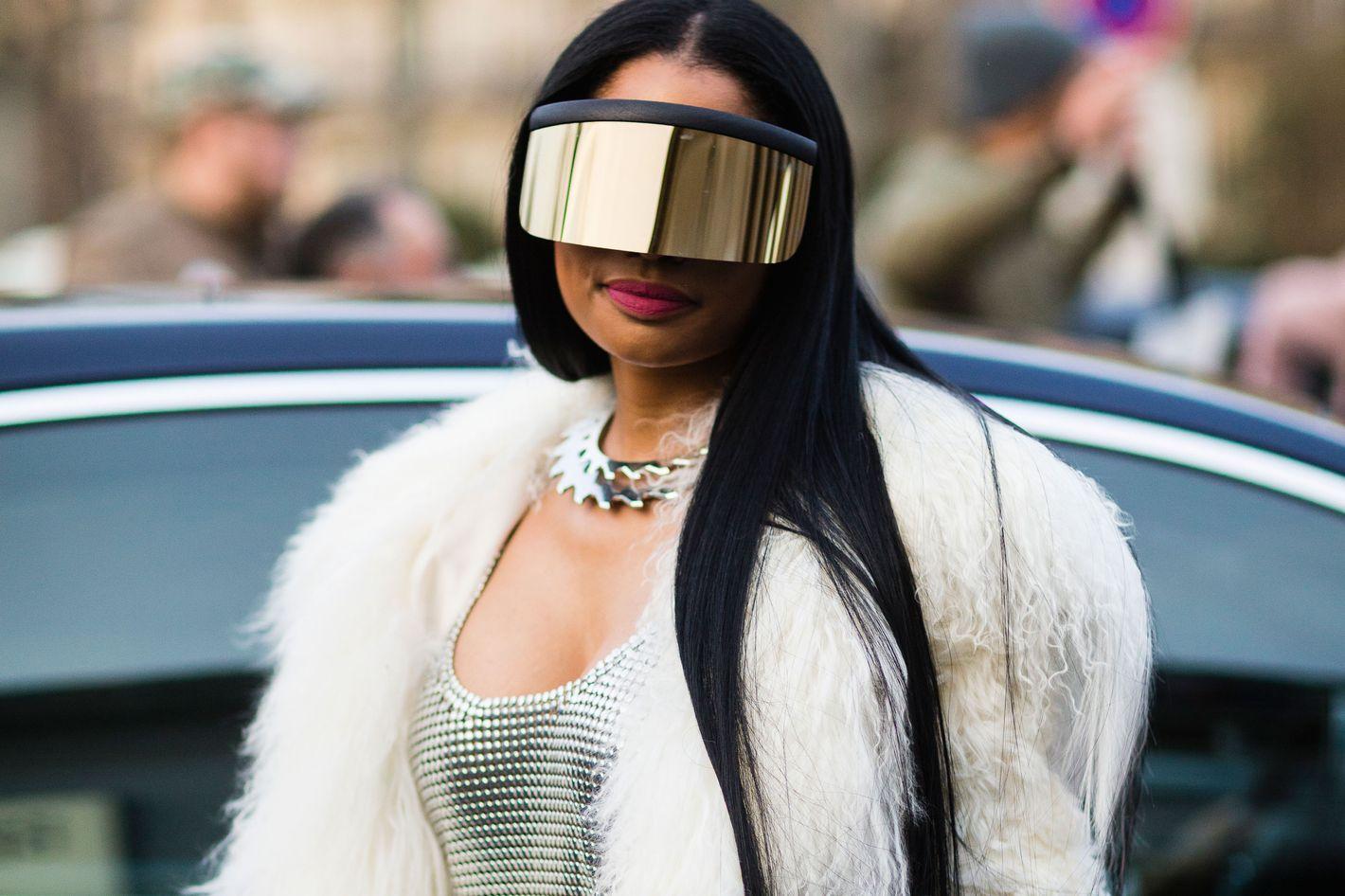 1e3a5ad830 Nicki Minaj Attends the Rick Owens Show in Crazy Sunglasses
