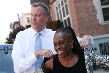 NEW YORK, NY - AUGUST 15:  New York City Democratic Mayoral candidate Bill de Blasio (L) stands with his wife Chirlane McCray before a press conference outside the East Side Community High School on August 15, 2013 in New York City. De Blasio spoke about his plan to tax the wealthy in order to expand city's after-school programs.  (Photo by Mario Tama/Getty Images)