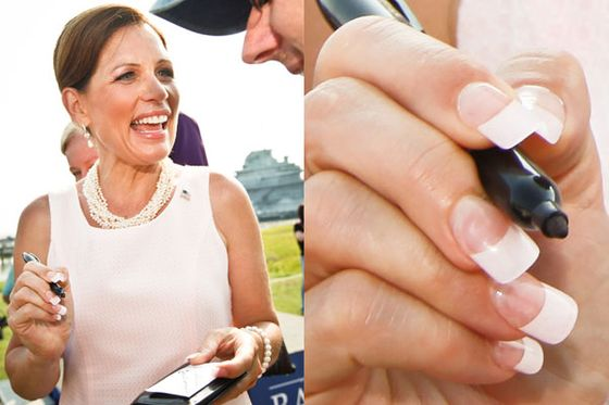"Bachmann's squared-off French tips were ablaze at a campaign event in South Carolina. This appears to be the same pale pink dress she described in her memoir, in a scene where President Bush gives her style advice. <a href=""http://www.politico.com/blogs/click/1111/Bush_told_Bachmann_Lose_the_pink_gloves.html"">Fox News summarizes</a>: ""Hewing to her mother's advice to appear 'ladylike' in public, Bachmann had donned a pink suit and pink gloves. At one point along their campaign route, the 43rd president asked Bachmann, 'with a crinkly smile,' why she was wearing gloves. After she explained, Bush said gently: 'Lose the gloves.'"""
