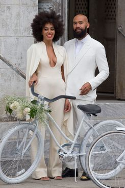 Solange Knowles and Alan Ferguson arrive at their wedding on white bicycles. Solange wore a white backless jumpsuit to her New Orleans nuptials.