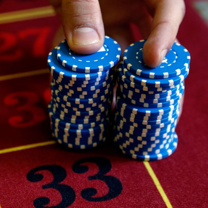 A young croupier trainee displays chips on a gaming table at the Cerus Casino Academy in Marseille