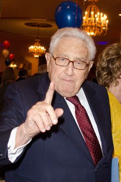 Henry Kissinger strikes a pose.