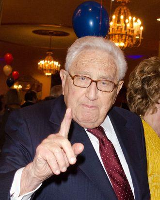Henry Kissinger strikes a pose.
