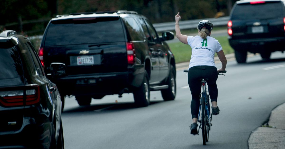 Woman Fired After Flipping Off Trump While Biking Past Motorcade