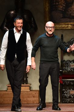 Italian designers Stefano Gabbana (L) and Domenico Dolce acknowledge the audience at the end of the show for fashion house Dolce & Gabbana as part of Autumn/Winter 2014 Milan Collections during the Men's fashion week on January 11, 2014 in Milan.