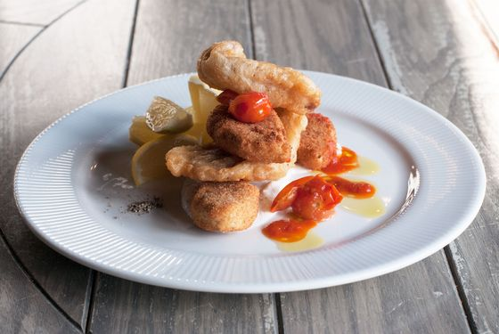 Crispy cod and ricotta with tomato and skordalia.