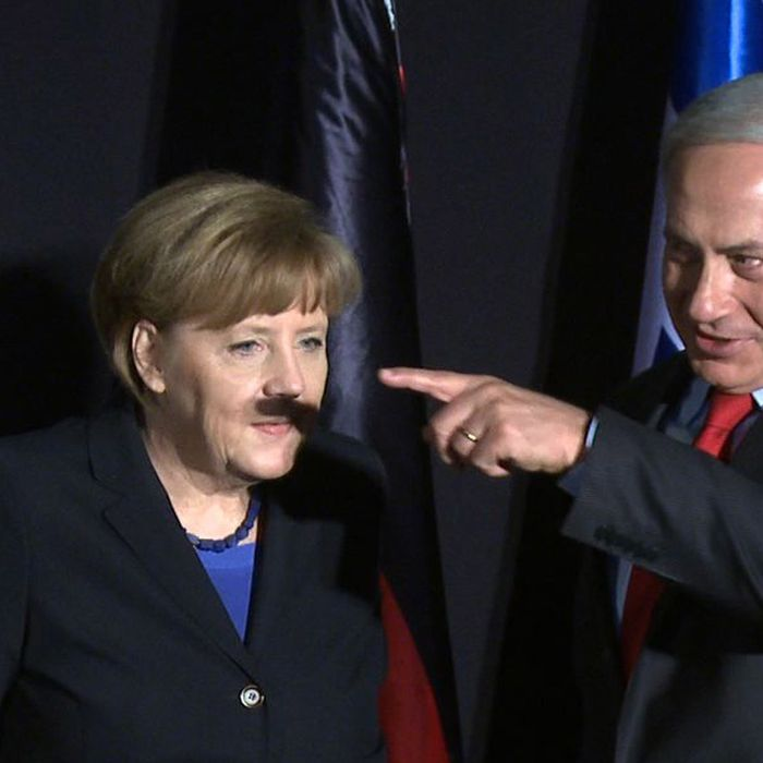 In this video-grab, German Chancellor Angela Merkel (L) and Israeli Prime Minister Benjamin Netanyahu gesture during a joint press conference after their cabinets held a meeting at the King David hotel in Jerusalem on February 25, 2014. Merkel arrived in Israel with her cabinet yesterday to discuss nuclear talks with Iran and to encourage Prime Minister Netanyahu to reach a two-state solution with the Palestinians.