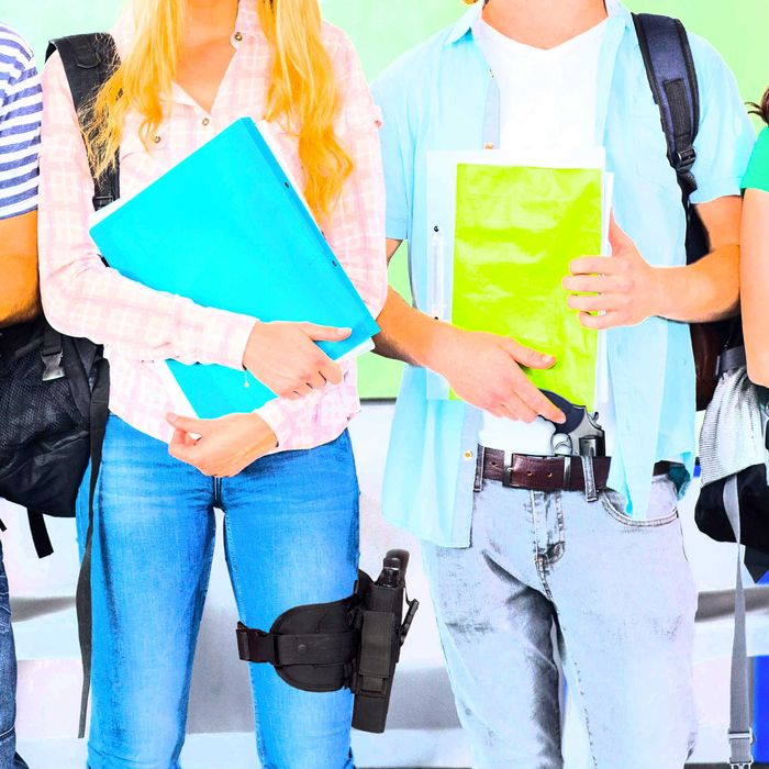 Happy college students holding folders
