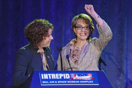 NEW YORK, NY - MAY 24:  Former Chief of Staff for Gabrielle Giffords, Pia Carusone (L) and former United States Rep. Gabrielle Giffords speak at Intrepid Sea-Air-Space Museum on May 24, 2012 in New York City.  (Photo by Mike Coppola/Getty Images)