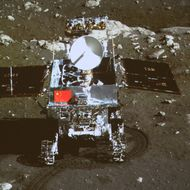 In this image taken by the on-board camera of the lunar probe Chang'e-3 and made off the screen of the Beijing Aerospace Control Center in Beijing, China's first moon rover 'Yutu' - or Jade Rabbit - is on the lunar surface in the area known as Sinus Iridum (Bay of Rainbows) Sunday, Dec. 15, 2013. Yutu touched down on the moon and left deep traces on its loose soil, state media reported Sunday, several hours after the country successfully carried out the world's first soft landing of a space probe on the moon in nearly four decades.