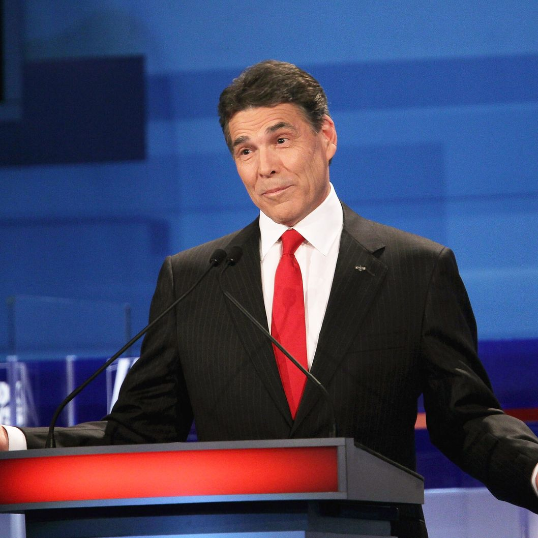 SIOUX CITY, IA - DECEMBER 15:  Republican presidential candidate Texas Gov. Rick Perry fields a question during the Fox News Channel debate at the Sioux City Convention Center on December 15, 2011 in Sioux City, Iowa. The GOP contenders are in the final stretch of campaigning in Iowa where the January 3rd caucus is the first test the candidates must face before becoming the Republican presidential nominee.  (Photo by Scott Olson/Getty Images)