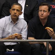 DAYTON, OH - MARCH 13:  U.S. President Barack Obama (L) and British Prime Minister David Cameron (R) eat a hot dog as they watch the first half at UD Arena as the Western Kentucky Hilltoppers take on the Mississippi Valley State Delta Devils in the first round of the 2011 NCAA men's basketball tournament on March 13, 2012 in Dayton, Ohio.  (Photo by Gregory Shamus/Getty Images)