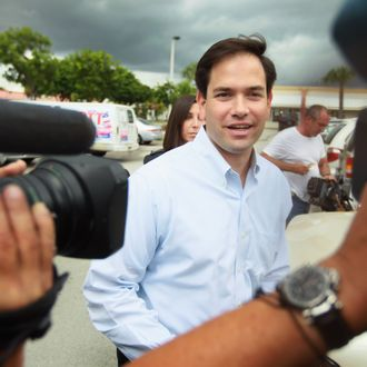 HIALEAH, FL - NOVEMBER 01: Republican Senate candidate Marco Rubio arrives during a visit to a campaign volunteer center on November 1, 2010 in Hialeah, Florida. Rubio is the front runner as campaigning comes to an end in the Florida Senate race against his opponent's independent candidate Charlie Crist and Democratic candidate Rep. Kendrick Meek (D-FL). (Photo by Joe Raedle/Getty Images) *** Local Caption *** Marco Rubio