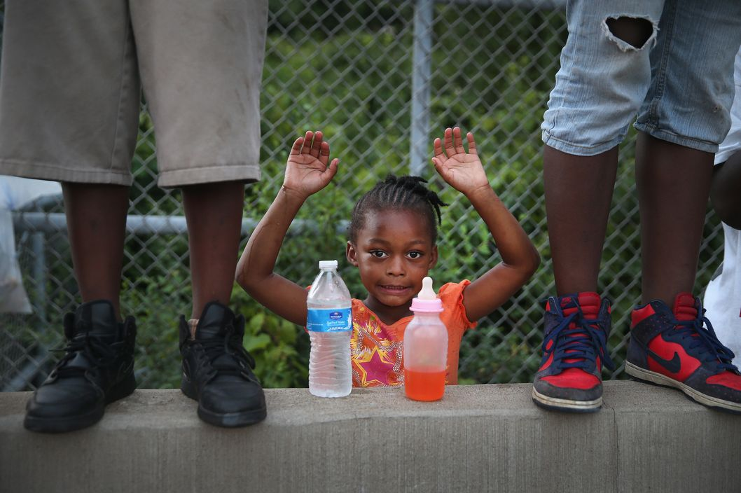FERGUSON, MO - AUGUST 17: Gabrielle Walker, 5,  protests the killing of teenager Michael Brown on August 17, 2014 in Ferguson, Missouri.  Despite the Brown family's continued call for peaceful demonstrations, violent protests have erupted nearly every night in Ferguson since his death. (Photo by Scott Olson/Getty Images)