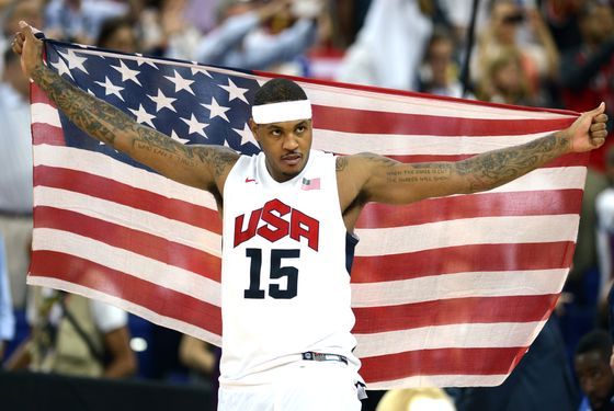 US forward Carmelo Anthony celebrates after the London 2012 Olympic Games men's gold medal basketball game between USA and Spain at the North Greenwich Arena in London on August 12, 2012.    AFP PHOTO / TIMOTHY A.  CLARY        (Photo credit should read TIMOTHY A. CLARY/AFP/GettyImages)