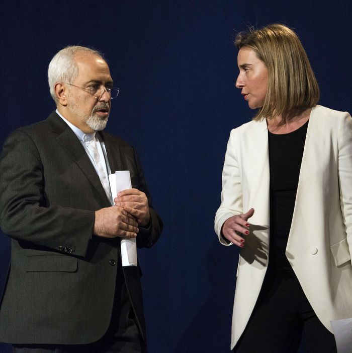 (From L) US Secretary of State John Kerry, Iranian Foreign Minister Javad Zarif and European Union High Representative for Foreign Affairs and Security Policy Federica Mogherini arrive to deliver a statement at the Swiss Federal Institute of Technology in Lausanne (Ecole Polytechnique Federale De Lausanne) on April 2, 2015, after Iran nuclear program talks finished with extended sessions. European powers and Iran on April 2 hailed a breakthrough in talks on reaching a deal to curtail Tehran's nuclear programme. AFP PHOTO / POOL / BRENDAN SMIALOWSKI (Photo credit should read BRENDAN SMIALOWSKI/AFP/Getty Images)