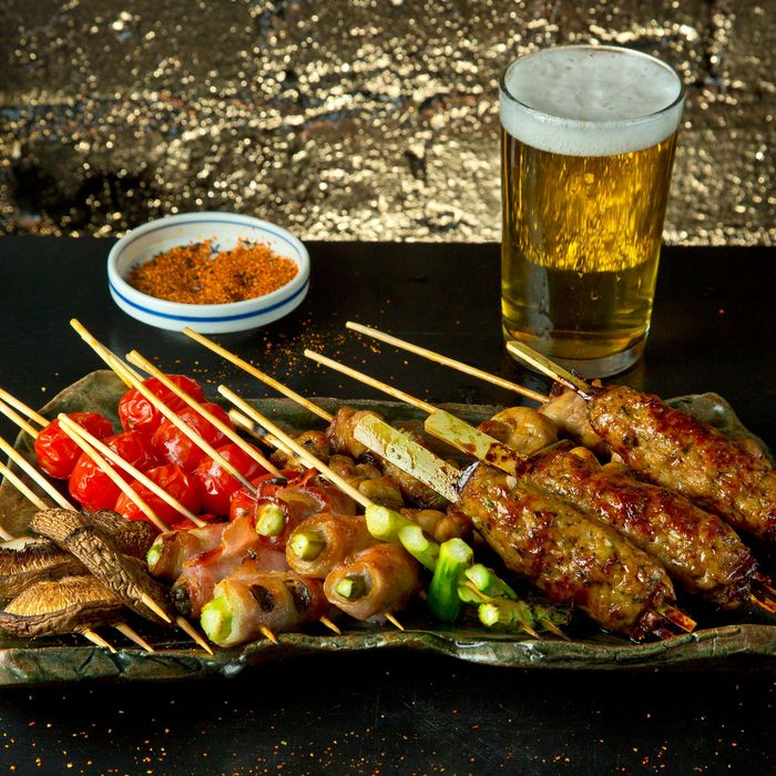Yakitori galore; skewered choices include shishito peppers stuffed with Japanese chicken meatballs.