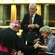 VATICAN CITY, VATICAN - OCTOBER 06: Bishop Msgr Vincenzo Paglia (L) greets a couple before the first sessions of the Synod on the themes of family at the Synod Hall on October 6, 2014 in Vatican City, Vatican. Pope Francis addressed the Fathers of the Extraordinary Assembly of the Synod of Bishops on Monday, as they began their first full day of sessions exploring the pastoral challenges of the family in the context of evangelization. (Photo by Franco Origlia/Getty Images)