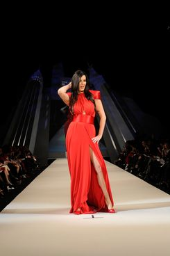 Patti Stanger walks on the runway wearing a Marc Bouwer design at The Heart Truth's  Red Dress Collection 2012 Fashion Show at Hammerstein Ballroom on February 8, 2012 in New York City.