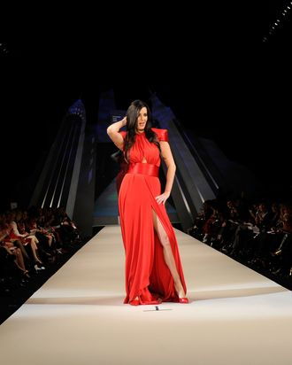 NEW YORK, NY - FEBRUARY 08: Patti Stanger walks on the runway wearing a Marc Bouwer design at The Heart Truth's Red Dress Collection 2012 Fashion Show at Hammerstein Ballroom on February 8, 2012 in New York City. (Photo by Frazer Harrison/Getty Images for Heart Truth)