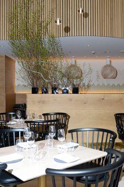 Light wood and Danish Modern furnishings define the space.