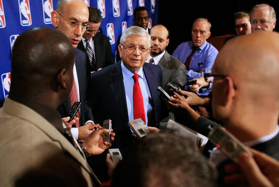 NEW YORK, NY - NOVEMBER 10:  NBA Commissioner David Stern (C) and NBA Deputy Commissioner Adam Silver speak  to members of the media after a press conference after the NBA and NBA Player's Association met to negotiate the CBA at The Helmsley Hotel on November 10, 2011 in New York City.  (Photo by Patrick McDermott/Getty Images)