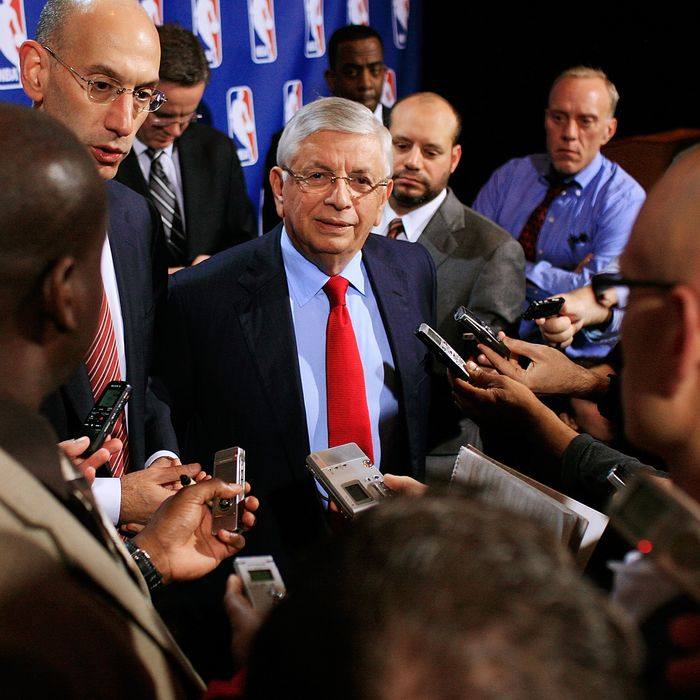 NBA Commissioner David Stern (C) and NBA Deputy Commissioner Adam Silver speak to members of the media after a press conference after the NBA and NBA Player's Association met to negotiate the CBA at The Helmsley Hotel on November 10, 2011 in New York City.