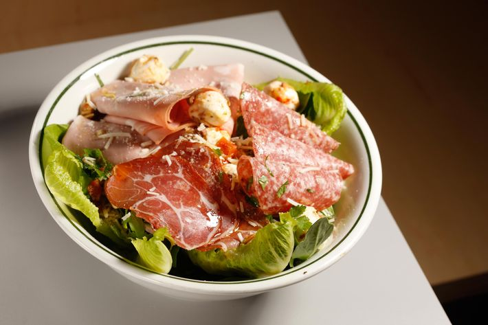 A hero in salad form, the Italian Chef salad is made with mortadella, copa, salami, mozzarella marinated in their Hoagie Spread, red onions, and red-wine vinaigrette.