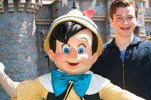 "ANAHEIM, CA - JULY 02:  In this handout photo provided by Disney, ""Glee"" star Chris Colfer meets his favorite Disney character, Pinocchio, at Disneyland on July 2, 2010 in Anaheim, California.  (Photo by Paul Hiffmeyer/Disneyland via Getty Images) *** Local Caption *** Chris Colfer"