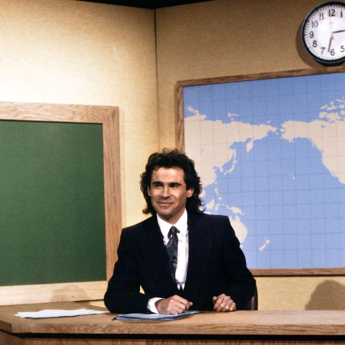 SATURDAY NIGHT LIVE -- Episode 4 -- Pictured: Dennis Miller during the 'Weekend Update' on November 15, 1986.