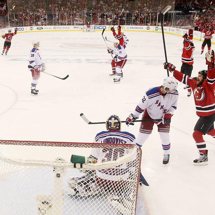 NEWARK, NJ - MAY 21: Travis Zajac #19 of the New Jersey Devils celebrates scoring a first period goal past Henrik Lundqvist #30 of the New York Rangers in Game Four of the Eastern Conference Final during the 2012 NHL Stanley Cup Playoffs at the Prudential Center on May 21, 2012 in Newark, New Jersey. (Photo by Bruce Bennett/Getty Images)
