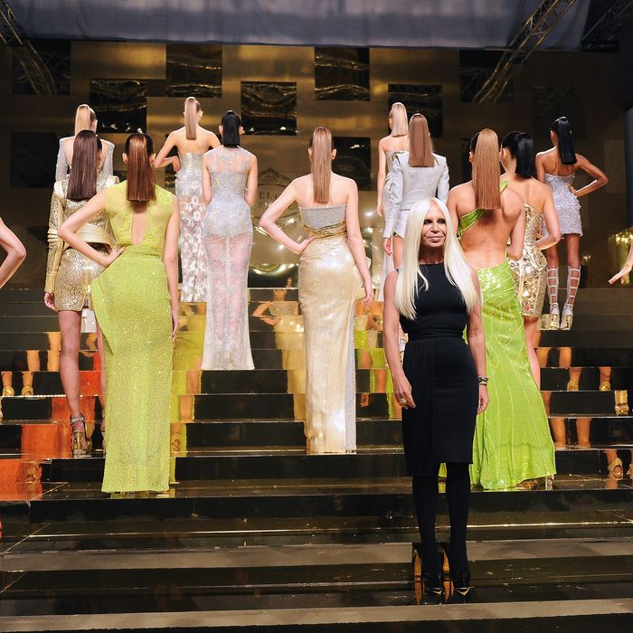 Donatella Versace poses with models on the catwalk during the Versace Haute Couture Spring/Summer 2012 Presentation as part of Paris Fashion Week on January 23, 2012 in Paris, France.