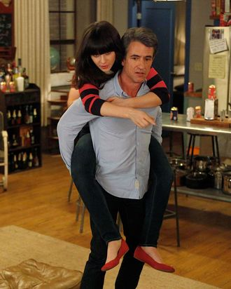 NEW GIRL: The gang plays drinking games when Jess (Zooey Deschanel, L) invites Russell (guest star Dermot Mulroney, R) to spend the weekend at the loft in the
