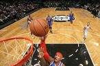 Carmelo Anthony #7 of the New York Knicks shoots against Reggie Evans #30 and Gerald Wallace #45 of the Brooklyn on Nets December 11, 2012 at the Barclays Center in the Brooklyn borough of New York City.