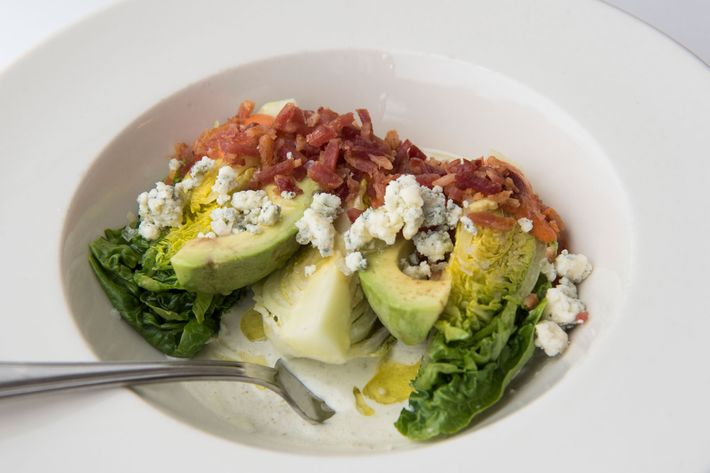 Baby gem salad with avocado, bacon, and blue cheese.