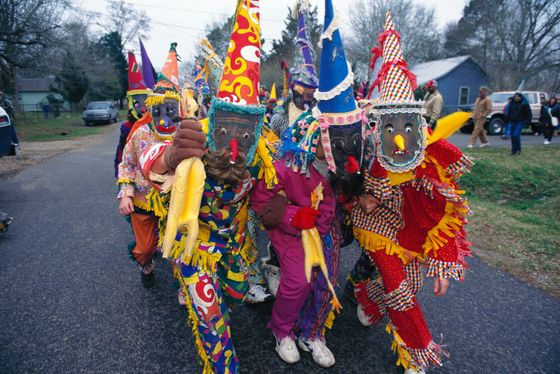 "February 1997, Louisiana, USA --- Original caption: Louisiana: Each year at Mardi Gras time, rowdy parades roll and revelers fight over worthless trinkets, an equally crazed celebration unfolds in the Cajun and Creole country 150 miles to the west. Hundreds of horseback riders dressed in medieval mummers costumes and masks gather for the purpose of chasing chickens. This is rural Mardi Gras, a pre-Lenten celebration from medieval Europe. As they have for generations for four days before Ash Wednesday, the celebrant go about collecting ingredients for a group gumbo, seeking ""charity"" - a dominion of rice, sausage, onions - or a chicken. If a chicken is offered it is not simply handed over, but tossed into flight and then frantically followed over fences, through fields and streams until it is caught by hand. While the poultry is being pursued, the other costumed characters dance, gulp beer and generally cut up. The --- Image by © Mark Peterson/Corbis"